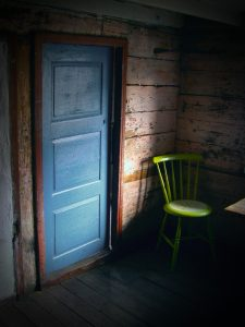 Door and chair at Helleren. Photo: Jon Ingemundsen