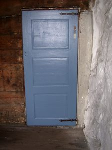 Picture of the blue door at Helleren, from the inside.
