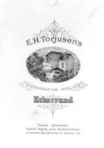 Reklame for E. H. Torjusen. Cirka 1900.